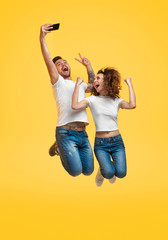Couple jumping and taking selfie