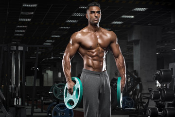 Foto op Plexiglas Fitness Muscular man working out in gym, strong arab male, naked torso abs