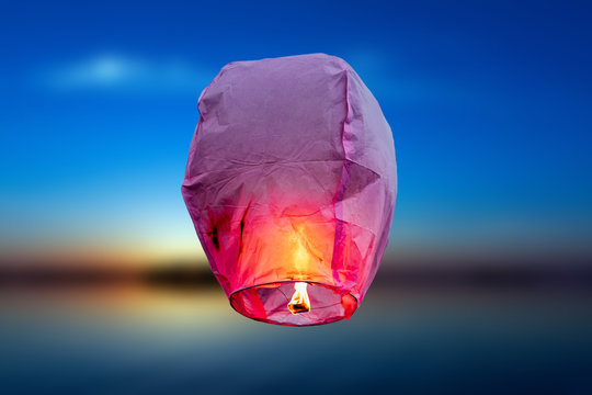 balloon fire Sky lantern flying lanterns, hot-air balloons Lantern flies up highly in the sky. Sea blur backgrounds