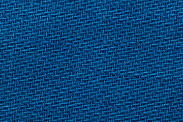 Blue fabric of cloth texture background. Detail of textile material close-up.