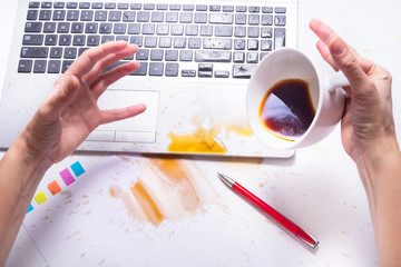 Spill coffee on a computer keyboard