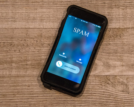 Cell Phone showing call from, Spam