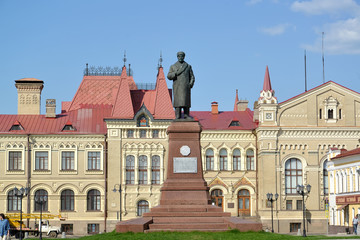 RYBINSK, RUSSIA. A monument to V.I. Lenin against the background of the building of Historical and architectural art memorial estate