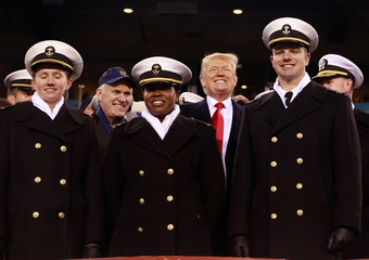 U.S. President Donald Trump is joined by Secretary of the Navy Richard Spencer at the Army-Navy college football game at Lincoln Financial Field in Philadelphia