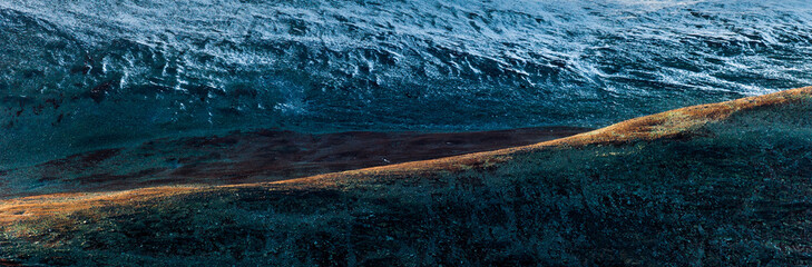 Sunlit hillside in the mountains of Rondane, Norway.