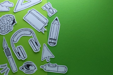 Creative Work Graphic Designer  Related Tools Symbols Devices Objects Top View Conceptual Composition With Hand Drawn Inked Paper Cutted Art On Green Background