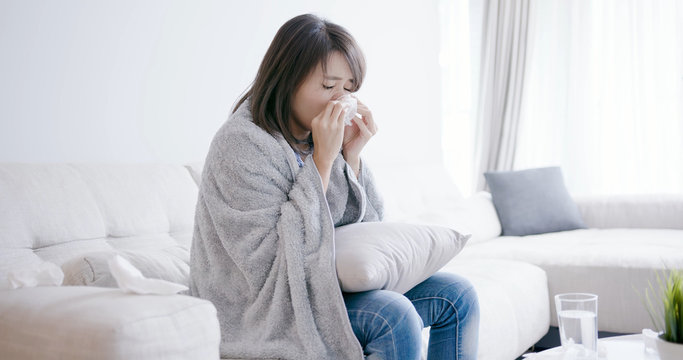 woman sick and sneeze