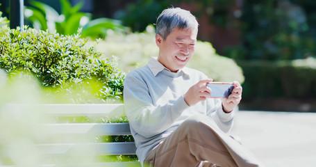 old man use smart phone