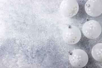 White Christmas balls. Light grey background. White Christmas. Copy space.
