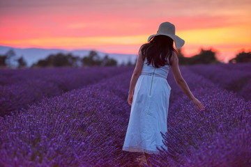 woman portrait in lavender flower fiel