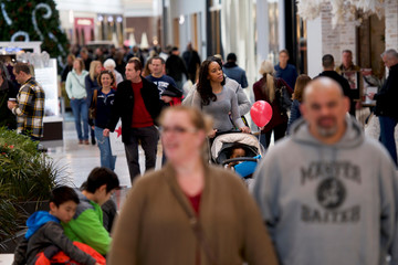 Shoppers walk through the King of Prussia Mall, United States' largest retail shopping space, in King of Prussia