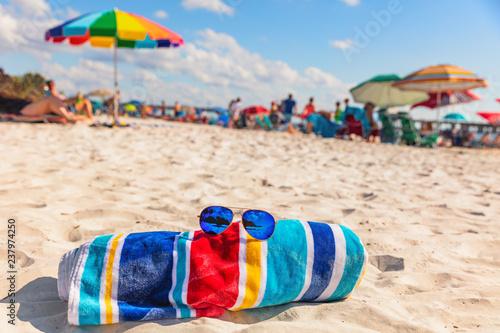 a274a868c0fc Beach towel and fashion sunglasses on Florida beach background -summer  vacation travel concept copy space