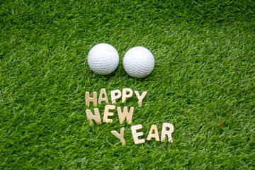 Golf Happy New Year on green grass