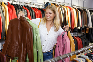 Woman choosing leather jacket