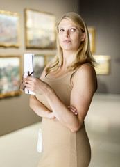 Woman with booklet looking at exhibits