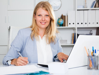 Smiling business woman working at workplace