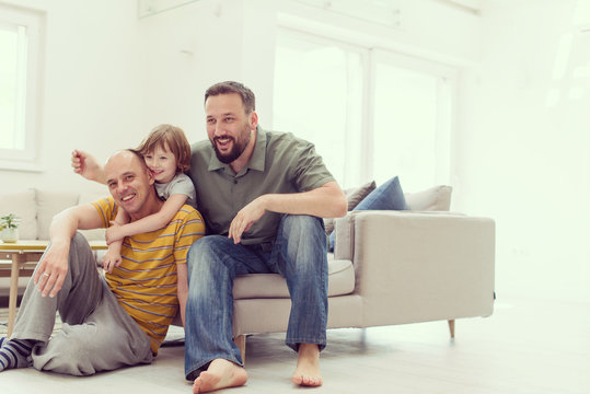Portrait of male gay couple with adopted childre