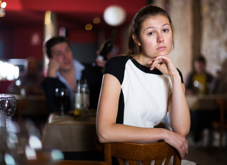 Offended woman at restaurant table