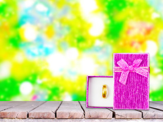 Gift Box on blurry christmas tree background, holiday time.
