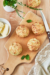 Baked zucchini muffins with cheese and herbs, top view