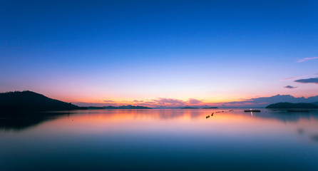 Colorful dramatic sky and seascape with reflection in the sea scenery of nature in evening sunset time