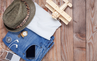 Outfit of traveler and accessories on wood background with copy space, Travel and tour concept