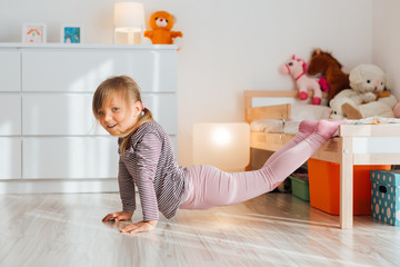 Little girl having fun at home