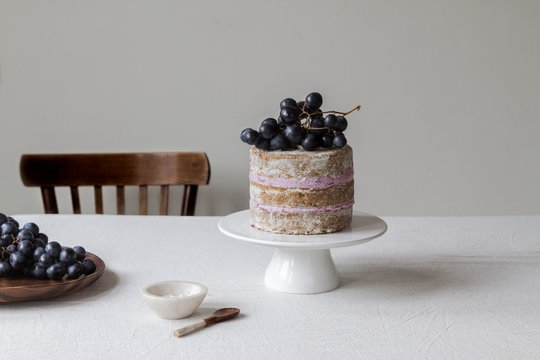 black grapes layered cake with fresh produce on the table