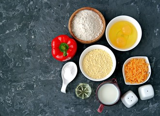Ingredients for cooking corn unleavened bread: wheat flour, red peppers, corn flour, oil, salt, pepper, grated cheddar cheese, baking powder, eggs, milk or buttermilk.