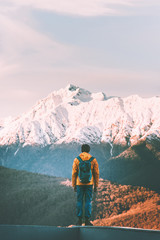 Man traveler walking alone in sunset mountains active lifestyle winter vacations outdoor hiking adventure solitude and silence