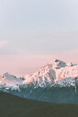 Zelfklevend Fotobehang Groen blauw Snowy mountains peaks range landscape travel aerial view wilderness nature tranquil evening winter sunset scenery