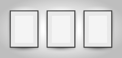 Three realistic empty rectangular black frames with passepartout on gray background, border for your creative project, mock-up sample, picture on the wall, vector design object