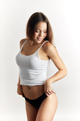 cheerful fit girl showing her healthy smoothy tan. close up portrait. joyful girl having fun