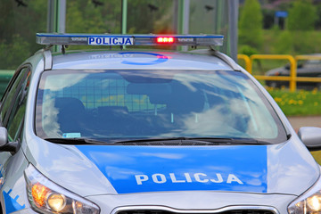 close up on Policja (Police) sign on car. Poland