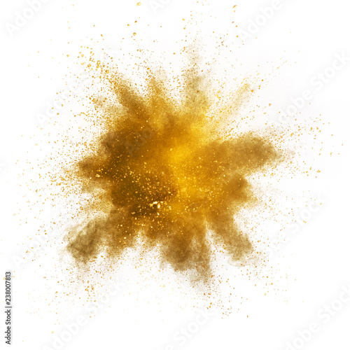 Fototapete Explosion of yellow powder on white background