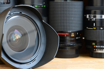 Professional photographic art equipment. Assortment of modern lenses