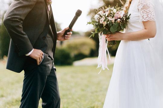 Groom reading wedding vows