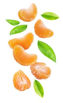 Falling mandarins isolated on white background