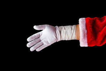 santa claus hurt hand with wrapping on black background