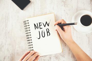 woman hand new job on notepad