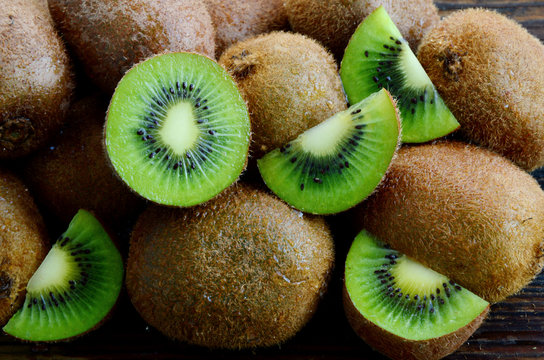 A lot of fresh Kiwi fruits  on wooden floor.