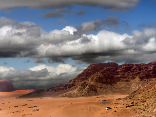 Aerial photograph of a dark dramatic sky with many clouds over the desert Wadi Rum in Jordan, combined image, taken with the drone