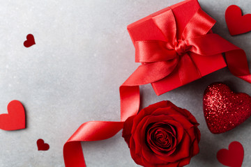 Gift box, rose flower and hearts for Valentines day card.