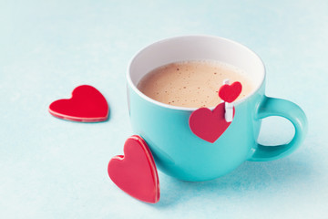 Cup of coffee and hearts for Valentines day breakfast.