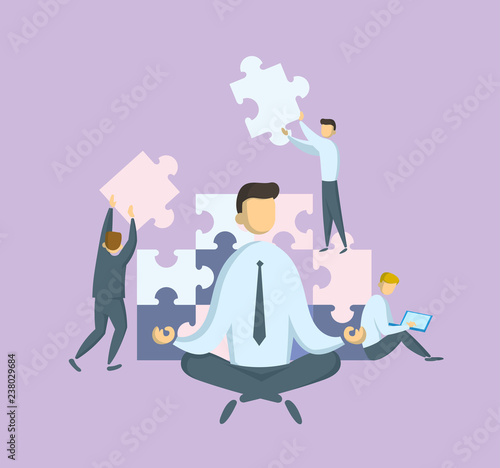 Businessman in lotus pose watching puzzle pieces being put