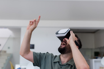 man with beard trying vr glasses