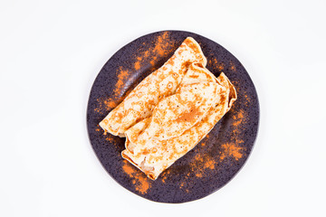 Pancakes stuffed with braised apples sprinkled with cinnamon