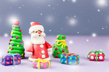 Merry Christmas greeting card with decorations. Santa Claus, Christmas tree and presents with snow falling