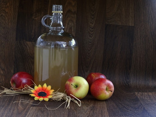 Flagon of Coudy Cider on Dark Wood
