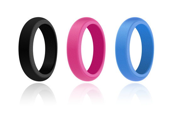3D style mock-up illustration of silicone rings of three colours: black, pink and blue. Realistic plastic texture. White background and glance shadow underneath